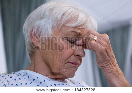 Close-up of tensed senior patient at hospital