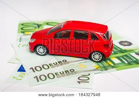 Toy Car And Euro Money - Insurance, Rent And Buying Car