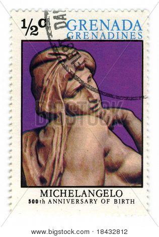 GRENADA - CIRCA 1975: A stamp printed in GRENADA dedicated artist Michelangelo di Lodovico Buonarroti Simoni 500th Anniversary of birth, circa 1975.