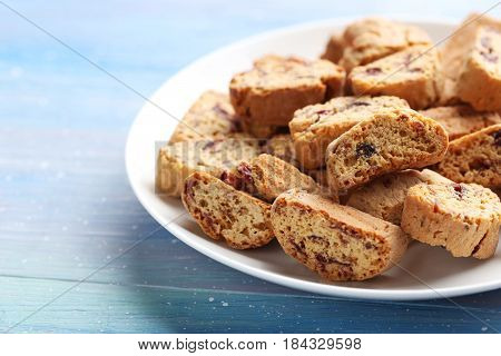 Cantuccini Cookies In Plate On Blue Wooden Table