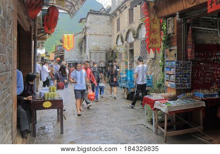 YANGSHOU CHINA - NOVEMBER 19, 2016: Unidentified people visit Xingping historical village. Xingping is a historical fishing village near Li river.