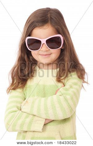 Young Girl with crossed arms smiling wearing Sunglasses