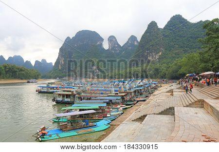YANGSHOU CHINA - NOVEMBER 19, 2016: Unidentified people take Li river scenic cruise boat.
