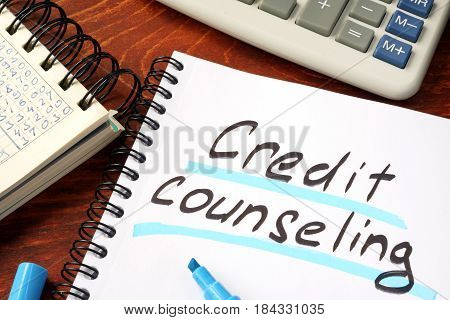 Credit counseling written in a note and calculator.