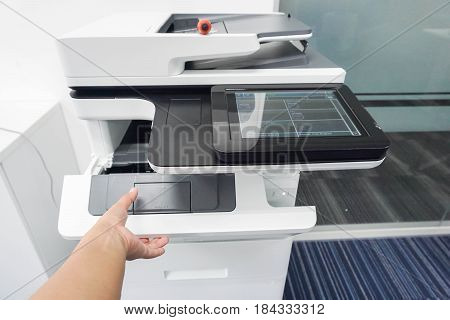 close up woman hand open printer and put ink toner cartridge