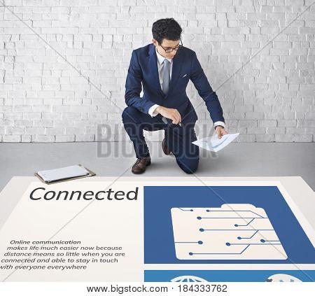 Man working on billboard network graphic overlay on floor