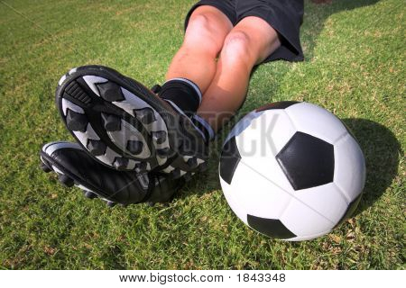 Football Player With A Soccerball On Soccer Pitch