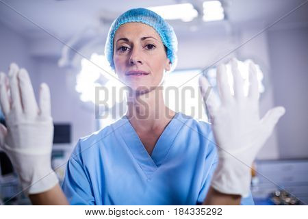 Portrait of female surgeon preparing for operation in operation room at the hospital