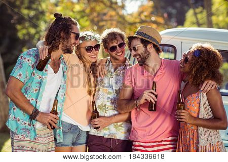 Group of friends having a beer together in park