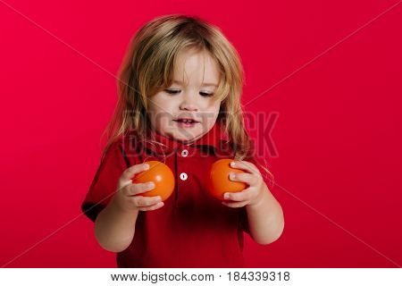 Small Baby Boy Play With Orange Balls