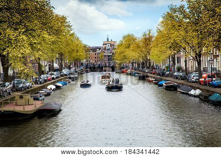 Amsterdam, Netherlands - April, 2017: Amsterdam canal view with boats