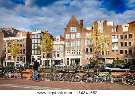 Amsterdam, Netherlands - April, 2017: Amsterdam canal view with bicycles and boats