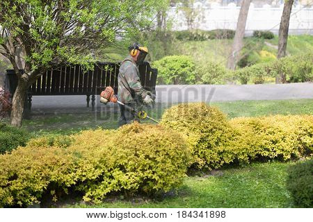 Gomel, Belarus - 29 April 2017: Workers Of The City Park Mow The Grass
