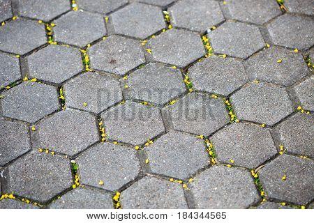 Grey brick stone street road. Light sidewalk pavement texture.