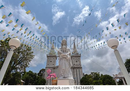 White statue of church of Saint Anna Nong Saeng and prayer colorful flags at Nakhon Phanom Province Thailand