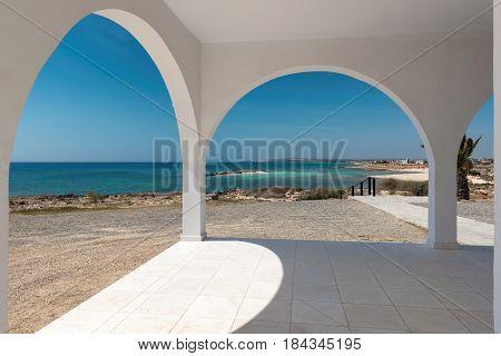 Cyprus beach at Mediterranean from white arches villa.
