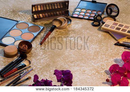 Different makeup items on the table - product photo with shallow depth of field.