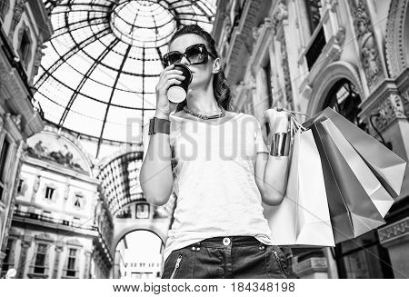Fashion Monger With Shopping Bags And Coffee Cup In Galleria