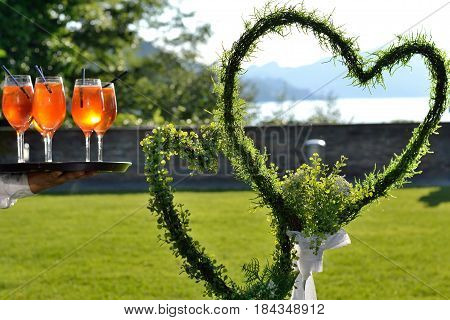 Two flower hearts as a wedding symbol and inviting cocktails