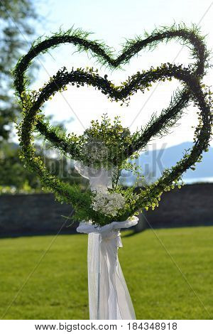 Flower arrangement in the form of two hearts as a symbol of a wedding