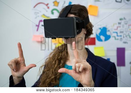 Close-up of woman using virtual reality headset in creative office