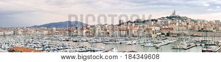 Marseille, France sunset. The famous european harbour view on the Notre Dame de la Garde panorama
