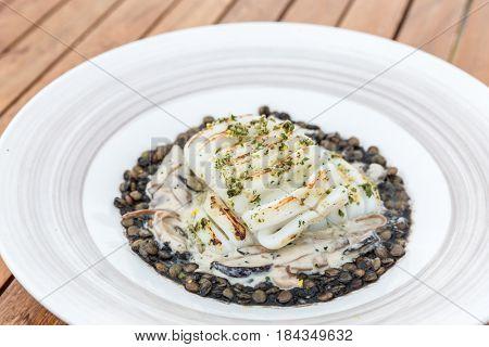 grilled squids with lentils nut mediterranean food cuisine