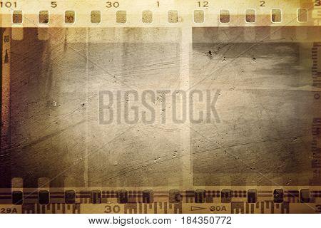 Film negative frames on brown background