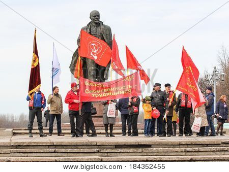 Kirishi, Russia - 1 May, People with holiday flags at the monument to Lenin,1 May, 2017. People at the May demonstration and rally in the Russian provincial government.