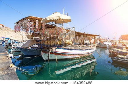 Seashells shop boat in the harbour of Rhodes, Dodecanese, Greece