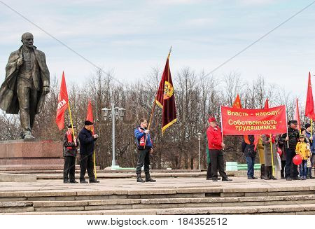 Kirishi, Russia - 1 May, People with festive flags and banners near the monument to Lenin,1 May, 2017. People at the May demonstration and rally in the Russian provincial government.