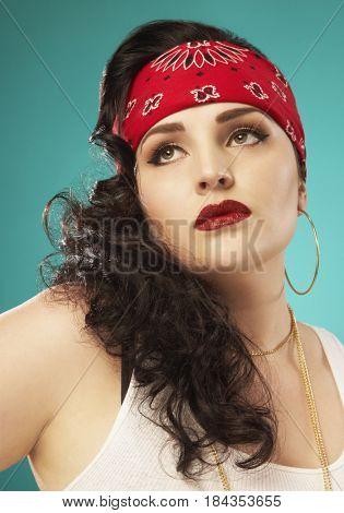 Glamorous Hispanic woman wearing bandana