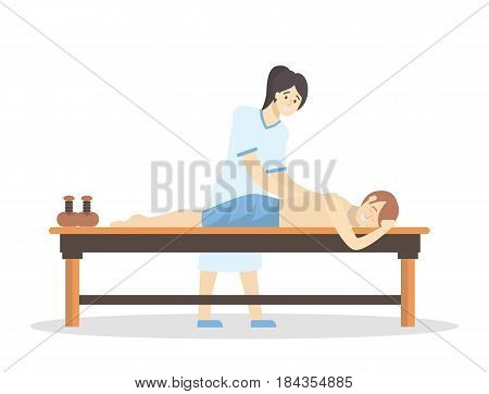 Massage in the spa salon. Woman does massage for man on white background