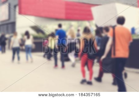City commuters. High blurred image of crowd people on street unrecognizable faces.