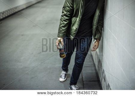 Homeless Alcoholism Man Holding Liquor Bottle