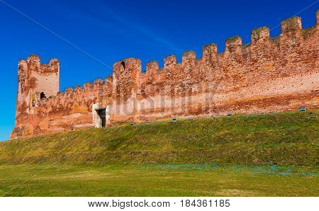 Walled city of Castelfranco Vento, small medieval city in Northern Italy, red brick wall with watchtower