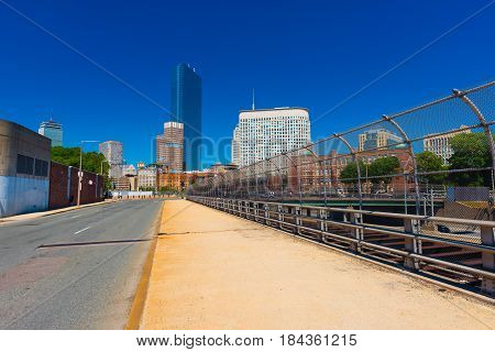 Boston - June 2016, MA, USA: View of commercial buildings in Boston downtown from the road with no traffic, cityscape against the clear blue sky