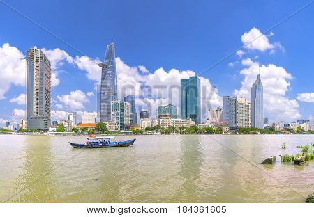 Ho Chi Minh City, Vietnam - May 1st, 2017:  Skyscrapers along river with architecture office towers, hotels, center cultural and commercial development country most in Ho Chi Minh city, Vietnam
