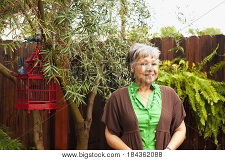 African American woman smiling in backyard