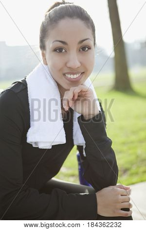 Mixed race woman with towel around her neck