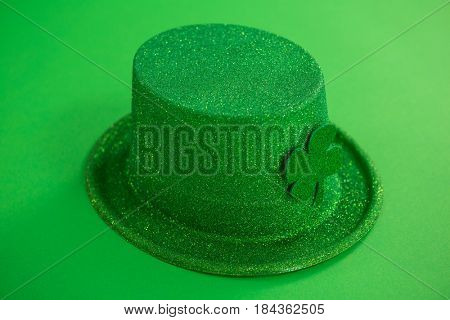 St Patricks Day leprechaun hat with shamrock on green background