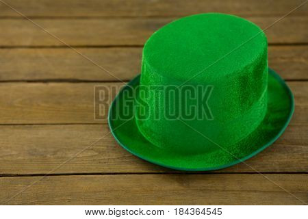 St Patricks Day leprechaun hat on wooden table