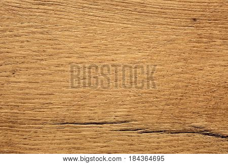 Old wooden plate with visible jars and scratches.Intractive background and texture.Horizontal view.