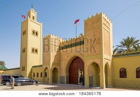 RISSANI ,MOROCCO - APRIL 4,2017 - Gate to Mausoleum of Moulay Ali Cherif in Rissani.The mausoleum of Moulay Ali Cherif third great-grandfather of Moulay Cherif founder of the Alaouite Dynasty of Morocco is located on the southern edge of town.
