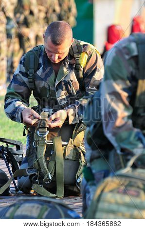 France Corsica Calvi - circa 2011. The parachutist of the 2nd parachute regiment of the French foreign legion checks his parachute before jumping.