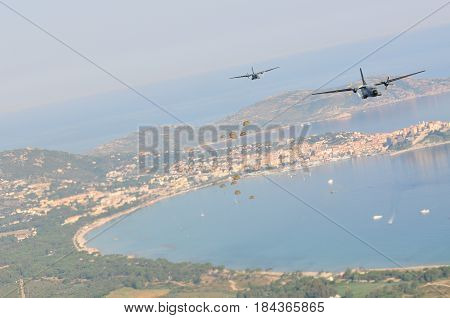 France Corsica Calvi - circa 2011.Transport aircraft with the Legionaires-paratroopers of the 2nd parachute regiment of the French foreign legion in the sky carry out the assault landing.
