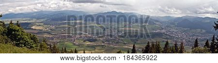 spectacular panorama with cities villages countryside and Velka Fatra and Nizke Tatry mountains from Predny Choc hill in Chocske vrchy mountains in Slovakia