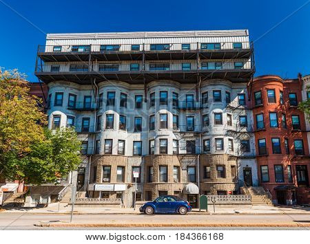 Boston - July 2016, MA, USA: Residential apartment building on one of the streets of Boston Back Bay neighborhood, unusual architecture style
