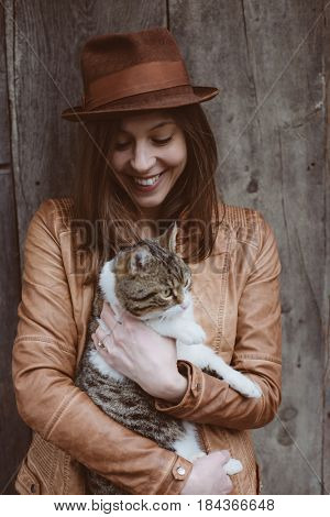Fashionable young woman with her cat