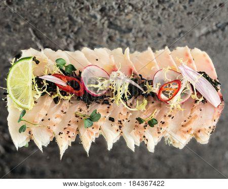 Sea bass new style sashimi over concrete background